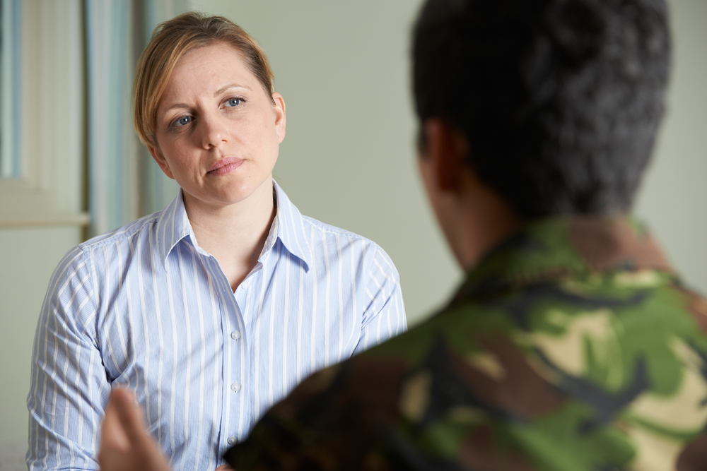 Soldier Suffering With Stress Talking To Counselor